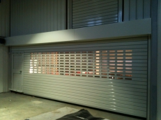The insulated shutters include a wicket door.