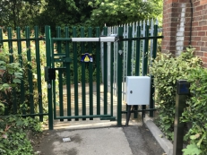 Pedestrian gate accessed via external call point and combined keypad.  Exit via internal disable push pad.